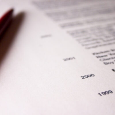 """Close-up on a professional resume (curriculum vitae) Some numbers in focus, rest is blurry."""
