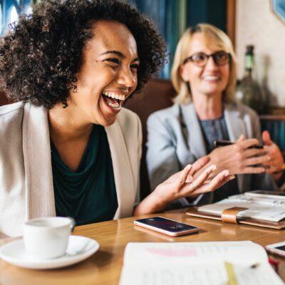 WOMEN TALKING AND HAVING COFFEE